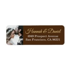 rustic wedding return address label with photo and names in gold on a brown base