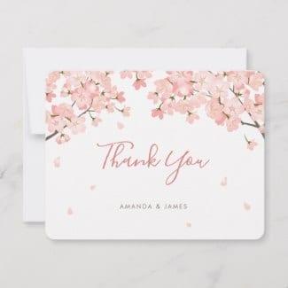 Thank you flat card featuring pink sakura Japanese cherry blossoms and a modern script.