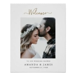 simple modern photo coupples shower welcome sign with white borders and gold script