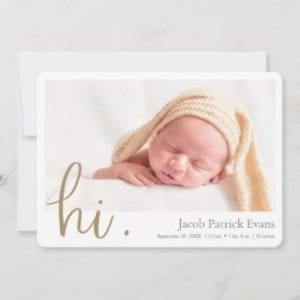 simple modern horizontal photo birth announcement card for a boy or girl with white borders and hi in gold script