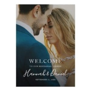 simple modern full photo wedding rehearsal dinner welcome sign with whimsical white script