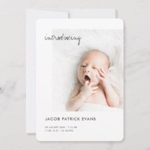 minimalist birth announcement card black and white with introducing in modern script with photo