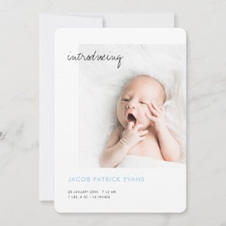 simple modern custom boy birth announcement with photo and name in baby blue
