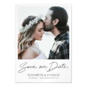 Simple modern save the date weddng magnet card with black script and borders.