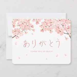 Japanese thank you cards with sakura cherry blossoms and hiragana arigato in a horizontal flat card format.
