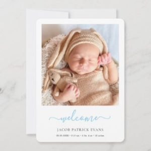simple modern baby boy announcement card with photo and blue script.