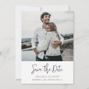 Simple modern wedding save the date cards with photo and names in gold.