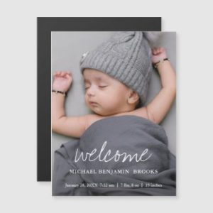 Baby photo announcement magnets with modern white welcome script.